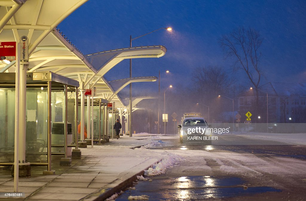 A car at a near empty Metro station during a snow storm March 3, 2014 in Vienna, Virginia. Snow began falling in the nation's capital early Monday, and officials warned people to stay off treacherous, icy roads a scene that has become familiar to residents in the Midwest, East and even Deep South this year. Schools were canceled, bus service was halted in places and federal government workers in the DC area were told to stay home Monday. AFP PHOTO / Karen BLEIER