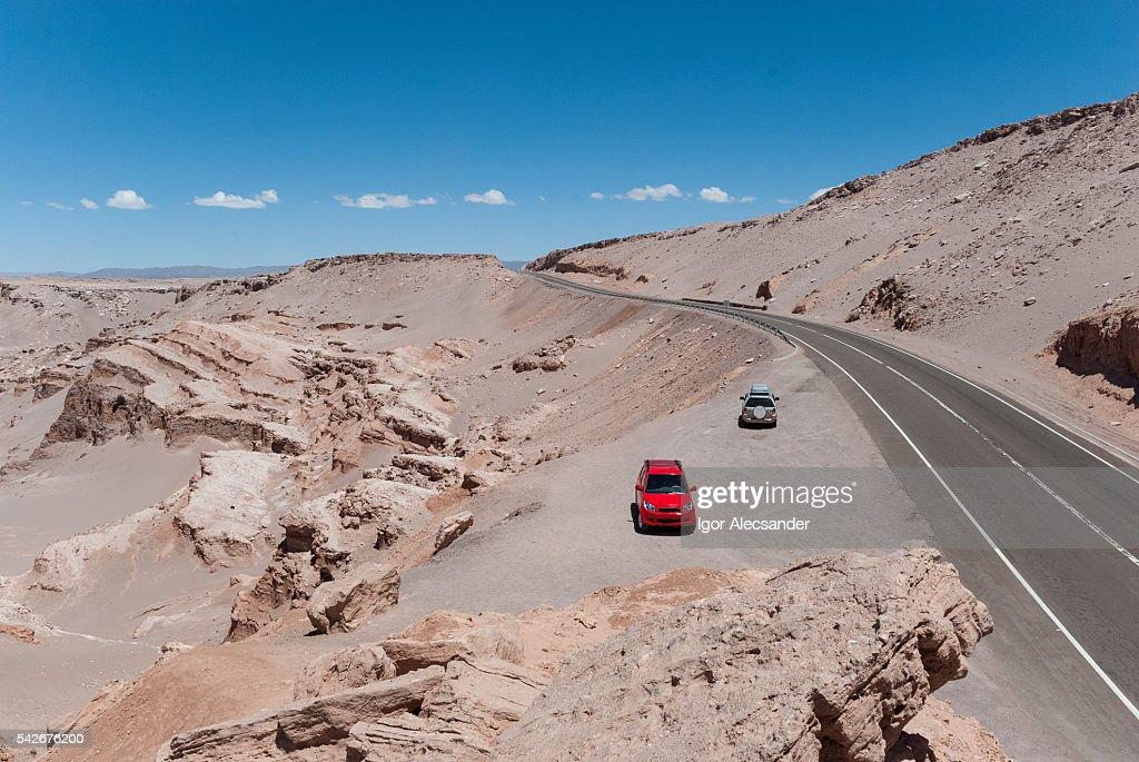 Car Atacama: cars stopped at the edge of road CH-23, Atacama Desert, Antofagasta, Chile