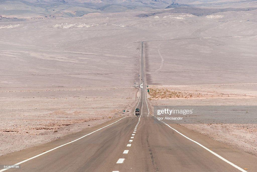 Car Atacama: Lonesome car crossing the road CH-23, Atacama Desert, Antofagasta, Chile