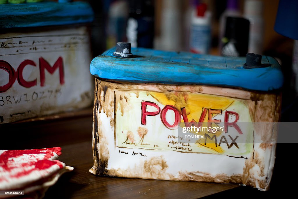 Car batteries made from entirely edible ingredients are displayed at a film set pop-up experience in east London on January 17, 2013. The event was held to promote the release of a new horror film 'The Helpers'.