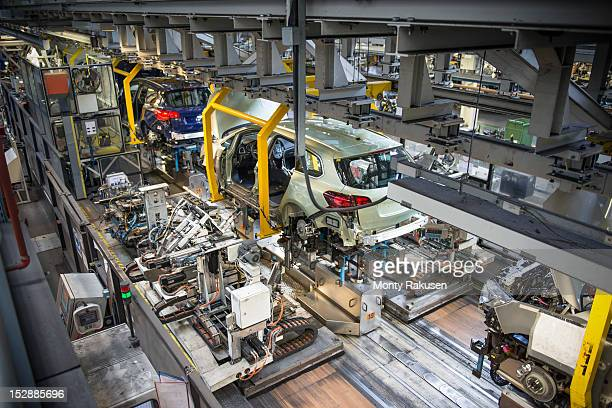 Car bodies being married with engines and suspension in car factory