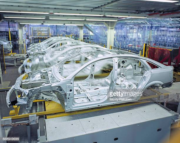 Car bodies on production line in car factory