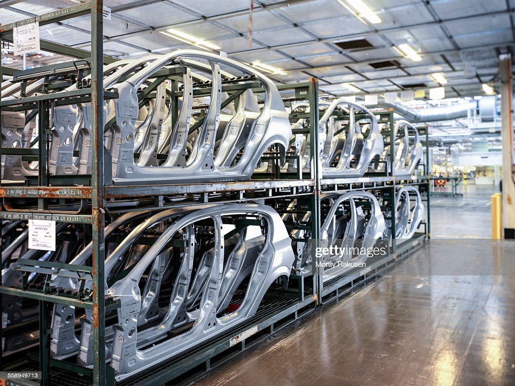 Car body parts in storage in car factory