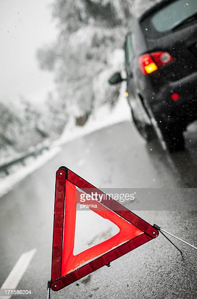Car breakdown on snowy road