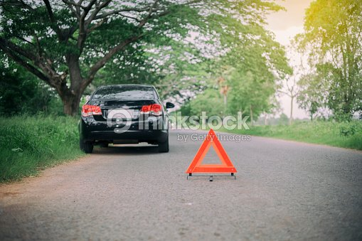 A Car Breakdown With Red Triangle Of On The Road Stock Photo