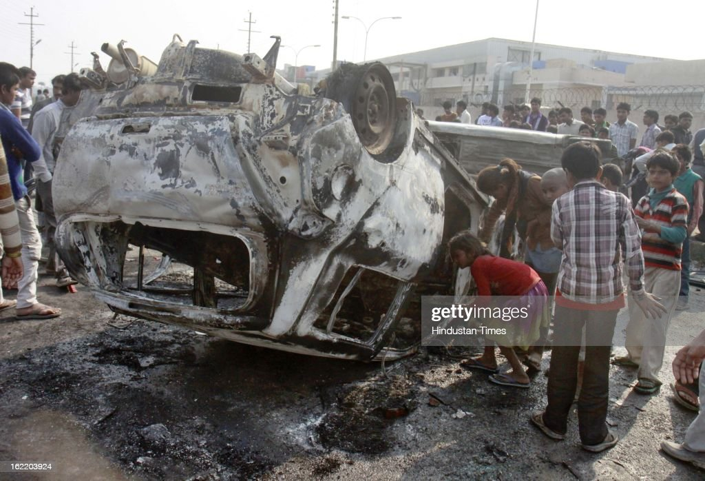 Car burned by mob outside a factory during 48 hours nationwide strike called by eleven major Trade Unions to protest Government's economic and labour policies on February 20, 2013 in Noida, India.