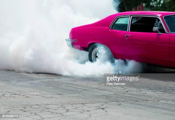 Car burning out and creating smoke.
