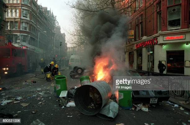 A car burns in Charing Cross Rod London in the wake of the riot which developed from a protest against the socalled Poll Tax in nearby Trafalgar...