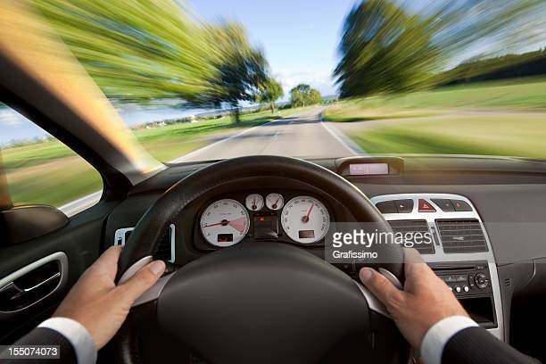 Car cabriolet interior with man in suit driving fast