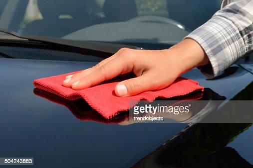 Auto-Pflege Polieren einem schwarzen Auto : Stock-Foto