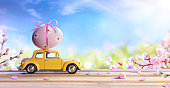 Car With Pink Flowers And Decorated Egg