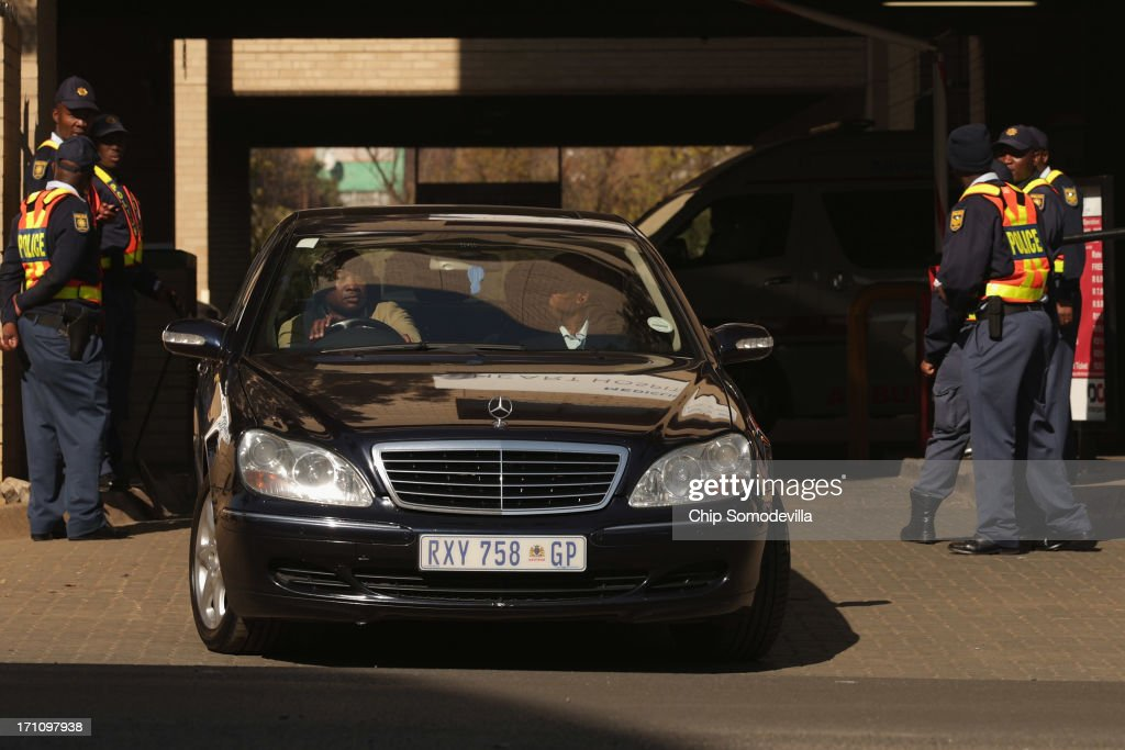 A car carrying former South African President Nelson Mandela's wife Graca Machel leaves the Mediclinic Heart Hospital where Mandela, 94, is being treated for a recurring lung infection June 22, 2013 in Pretoria, South Africa. The Nobel Peace Prize laurete and anti-aparteid icon has been in hospital for two weeks in 'serious but stable' condition, according to the South African government.