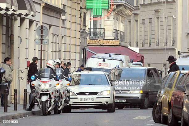 A car carrying Jerome Kerviel the French trader who allegedly cost banking giant Societe Generale 490 billion euros in losse arrives at the Financial...