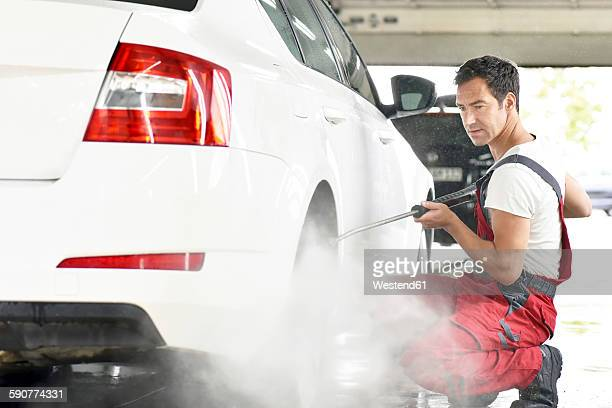 Car cleaning, man cleaning car with high-pressure cleaner