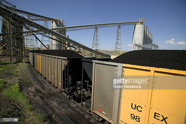 A 133 car coal train moves slowly as it's loaded at the Buckskin Coal Mine on June 13 2006 in Gillette Wyoming BNSF operates the train moving Powder...
