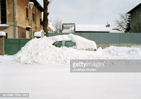 Car covered in snow drift