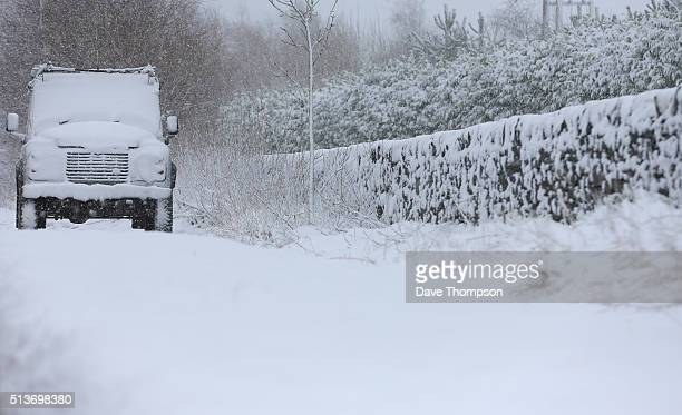 A car covered in snow parked on a roadside on March 4 2016 in Buxton England Parts of northern England have been hit by heavy snow as a result of...
