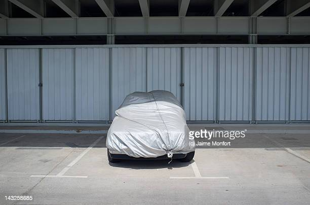 Car covered with tarp