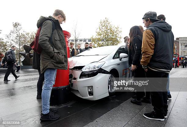 A car 'crashed' into a post box outside King's Cross Station in London United Kingdom on November 15 ahead of the launch of Jeremy Clarkson Richard...