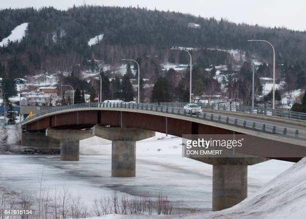 A car crosses over the International Bridge at the US/Canada border March 2 in Clair New Brunswick The truck is crossing from Caire to Fort Kent...
