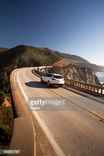 Car crossing the Bixby Bridge, Big Sur, California, USA