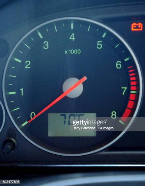 Car dashboard temperature gauge shows an outside temperature of 70F on the MonmouthshireGloucestershire border this afternoon
