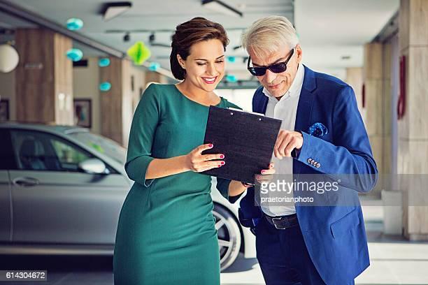 Car dealer sales car to the customer