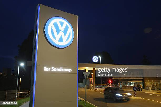 A car departs from an entrance gate at the Volkswagen factory and company headquarters on October 21 2015 in Wolfsburg Germany According to media...