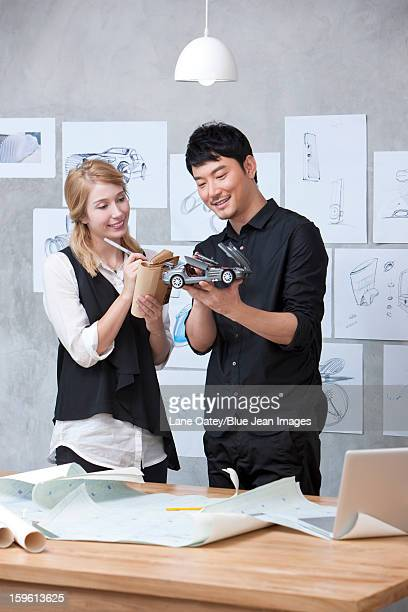 Car designer and assistant at work
