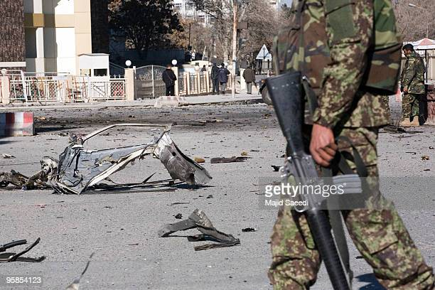 A car destroyed in a blast lies in the street following clashes between Talibanlinked militants and security forces on January 18 2010 in Kabul...