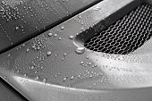 Closeup of droplets on grey car trunk