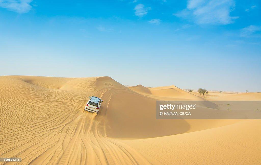 Car drifting on desert dunes