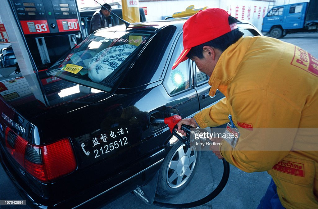 A car driver buys gasoline at a PetroChina station in Dali Yunnan Province
