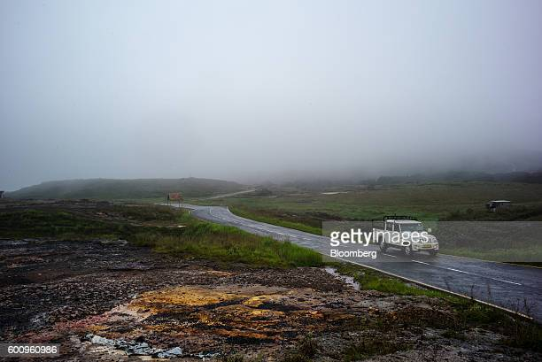 A car drives along a road shrouded in mist in Cherrapunji Meghalaya India on Saturday Aug 13 2016 Two years of deficient rainfall have affected more...