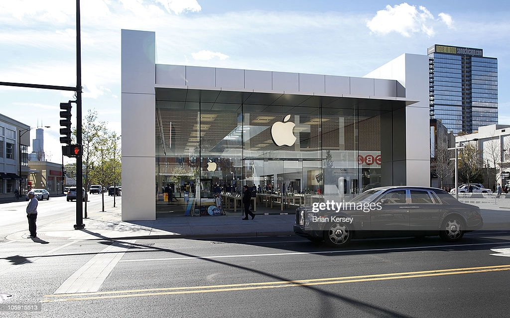 A car drives by the new Apple Store on October 21, 2010 in Chicago, Illinois. The new store opens on October 23 in Lincoln Park, a part of the city's Near North Side that has been trendy for several years.