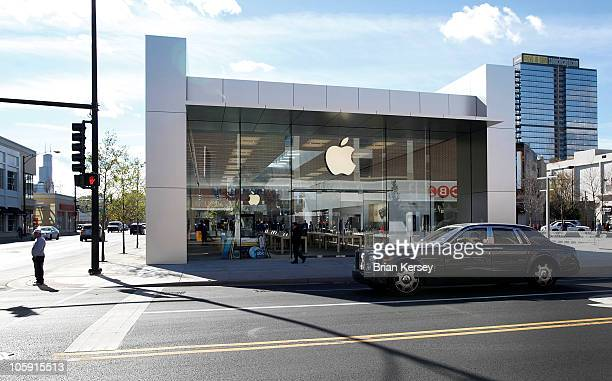 A car drives by the new Apple Store on October 21 2010 in Chicago Illinois The new store opens on October 23 in Lincoln Park a part of the city's...