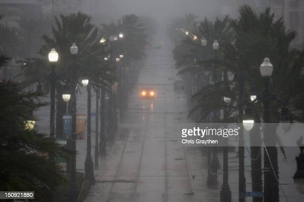 A car drives down Canal Street during Hurricane Isaac on August 29 2012 in New Orleans Louisiana The Category 1 hurricane is slowly moving across...
