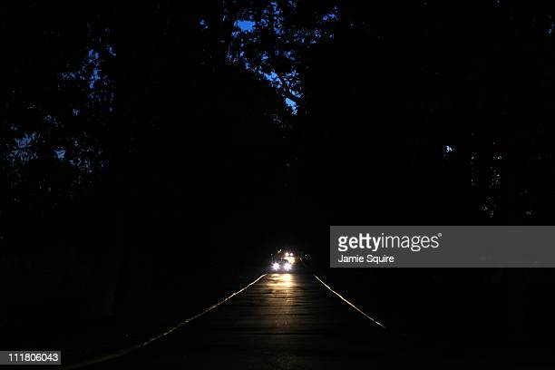 A car drives down Magnolia Lane prior to the start of the first round of the 2011 Masters Tournament at Augusta National Golf Club on April 7 2011 in...