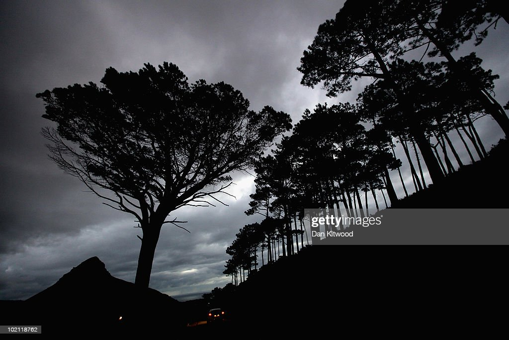 A car drives down Signal Hill towards Devil's Peak at dusk on June 15, 2010 in Cape Town, South Africa.