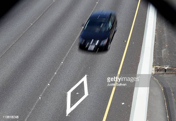 A car drives in the carpool lane on highway 101 on May 6 2011 in San Rafael California The California DMV announced that beginning June 30th hybrid...