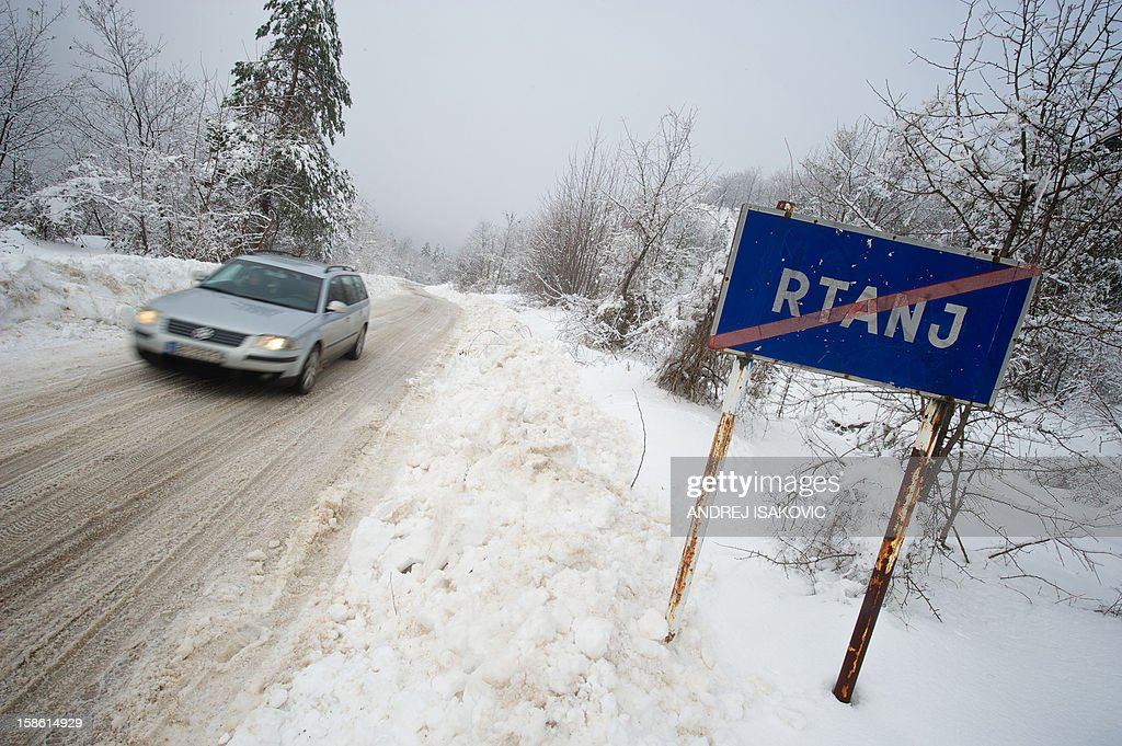 A car drives in to the village of Rtanj on December 21, 2012. A pyramid-shaped mountain in Serbia, believed by some to be a source of unusual electromagnetic waves that could shield it from catastrophe, was attracting record numbers of visitors ahead of the predicted Mayan apocalypse today. AFP PHOTO / ANDREJ ISAKOVIC