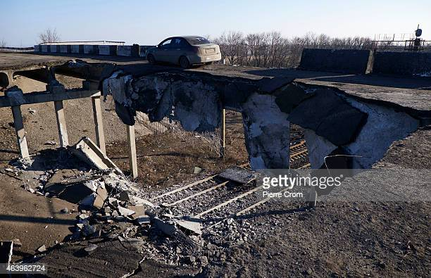 A car drives on a partly blown up bridge on February 20 2015 in Debaltseve Ukraine The strategic railway town of Debaltseve is of under the control...