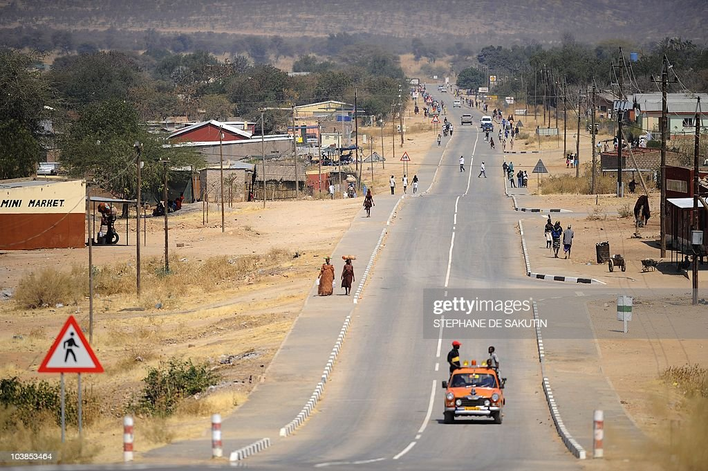 A car drives on August 21 2010 on the main street of Opuwo in northern Namibia AFP PHOTO / STEPHANE DE SAKUTIN