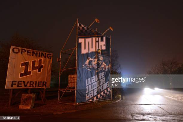 A car drives past a billboard with an advertisement for the Wavre Indoor Karting in Wavre a suburban town about 30 kilometres southeast of Brussels...