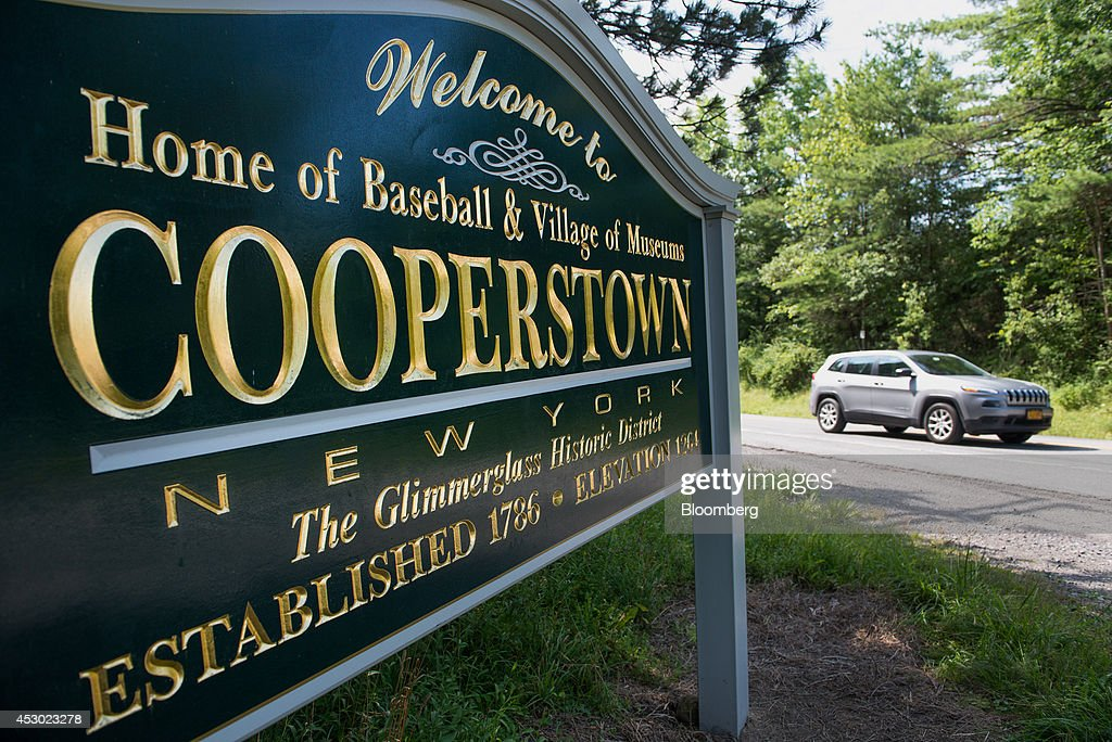 A car drives past a sign welcoming visitors in Cooperstown New York US on Saturday July 26 2014 President Obama during a visit to Cooperstown in May...