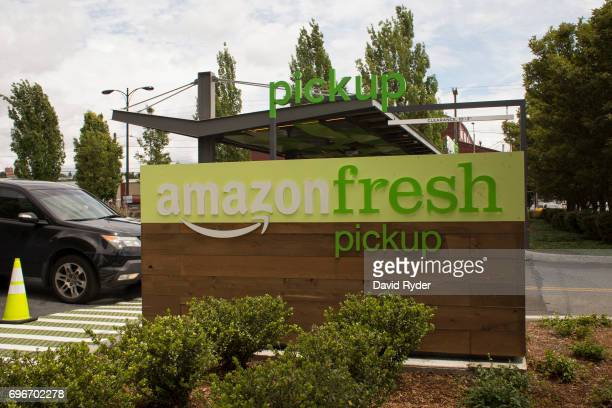 A car drives past an AmazonFresh Pickup location on June 16 2017 in Seattle Washington Amazon announced that it will buy Whole Foods Market Inc for...