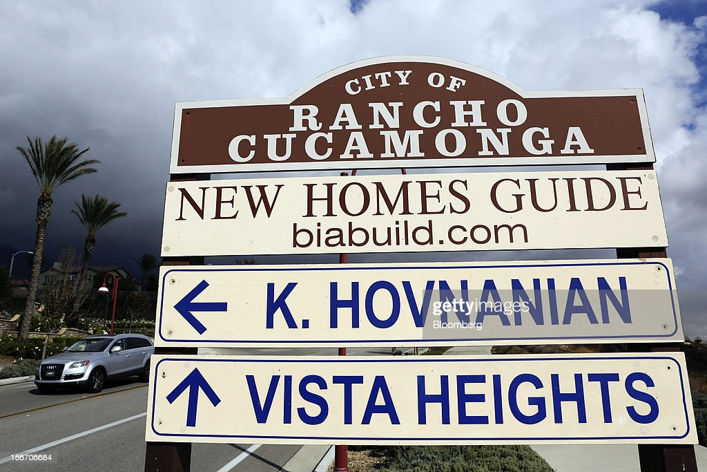 A car drives past City of Rancho Cucamonga sign directing potential house buyers to the K. Hovnanian Homes Pasadera and the Ryland Homes Vista Heights developments in Rancho Cucamonga, California, U.S., on Sunday, Nov. 18, 2012. The U.S. Census Bureau is scheduled to release housing starts figures on Nov. 20. Photographer: Patrick T. Fallon/Bloomberg via Getty Images