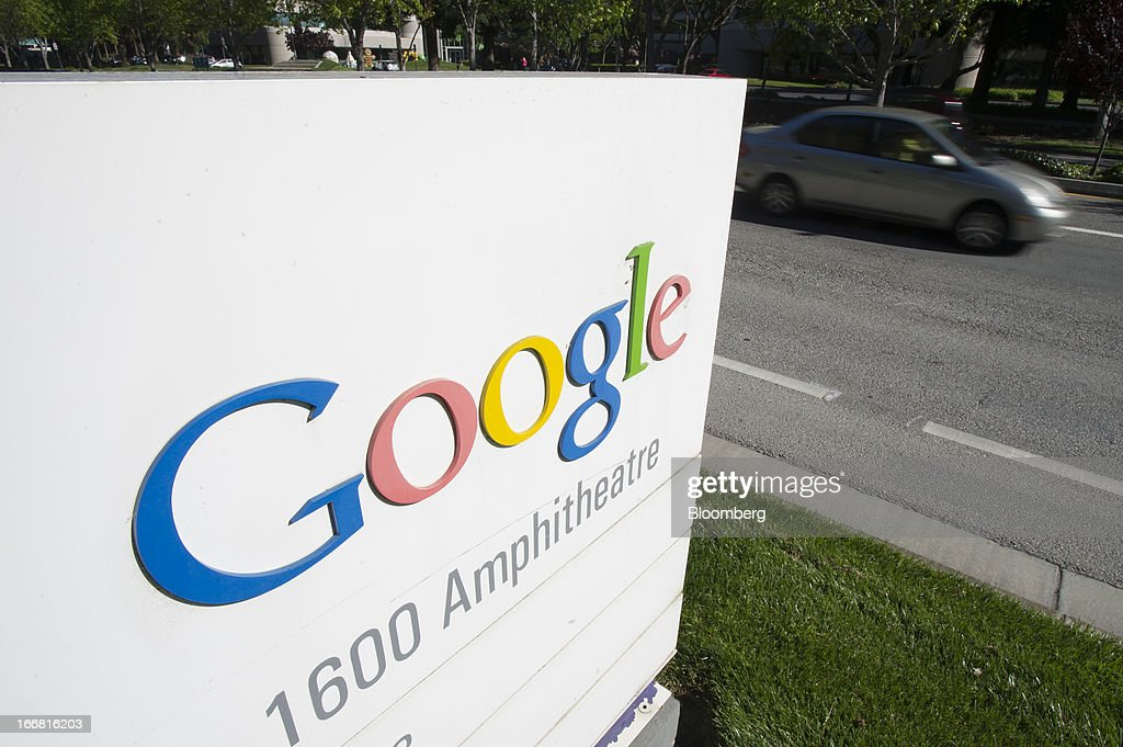 A car drives past Google Inc. signage displayed outside of the company's headquarters in Mountain View, California, U.S., on Tuesday, April 16, 2013. Google Inc. is expected to release earnings data on April 18. Photographer: David Paul Morris/Bloomberg via Getty Images
