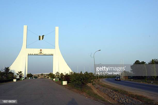 A car drives past the city gate to Abuja Nigeria's federal capital territory 27 November 2006 Nigeria's federal capital which is poised to host an...