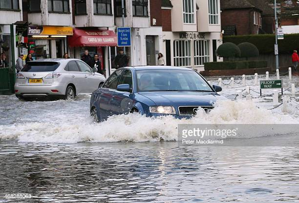 A car drives through flood water on the main road after the river Thames burst it's banks on February 10 2014 in Datchet England The Environment...